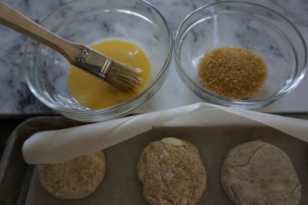 Brushing Egg Wash & Sugar onto Scones.