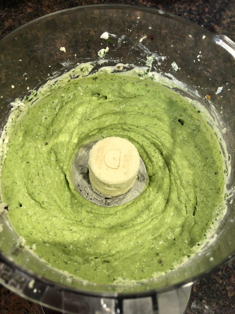 Vegan cheese manicotti filling in the food processor.