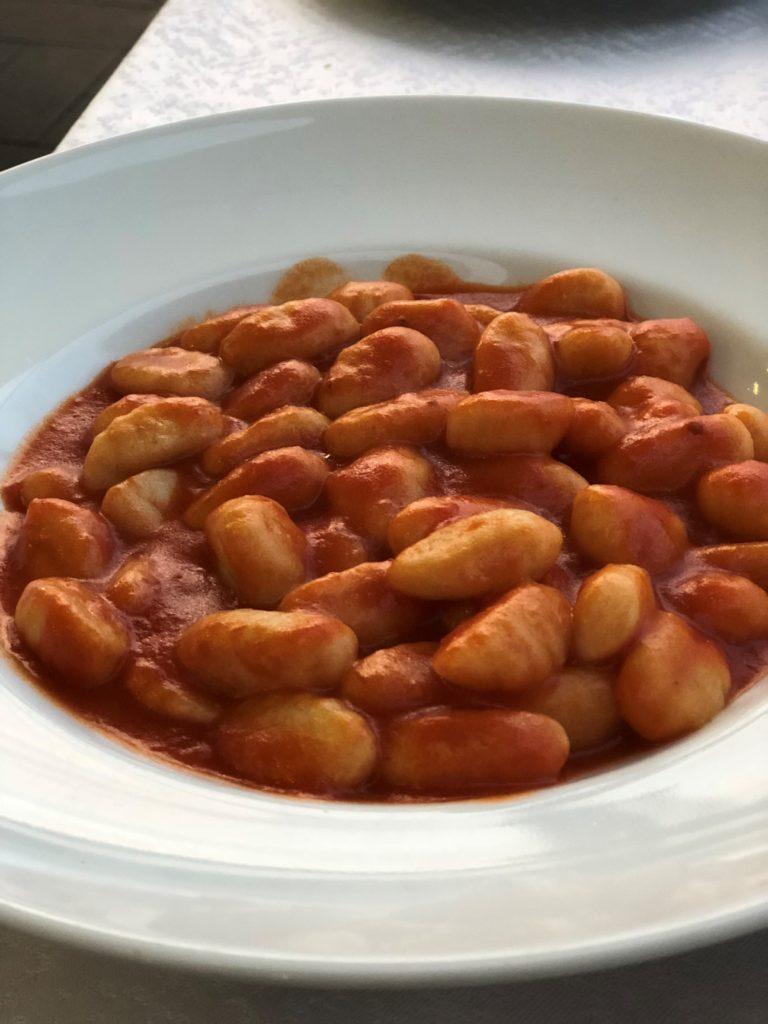 Gluten-free gnocchi with a garlic-free pasta sauce in Sorrento, Italy.