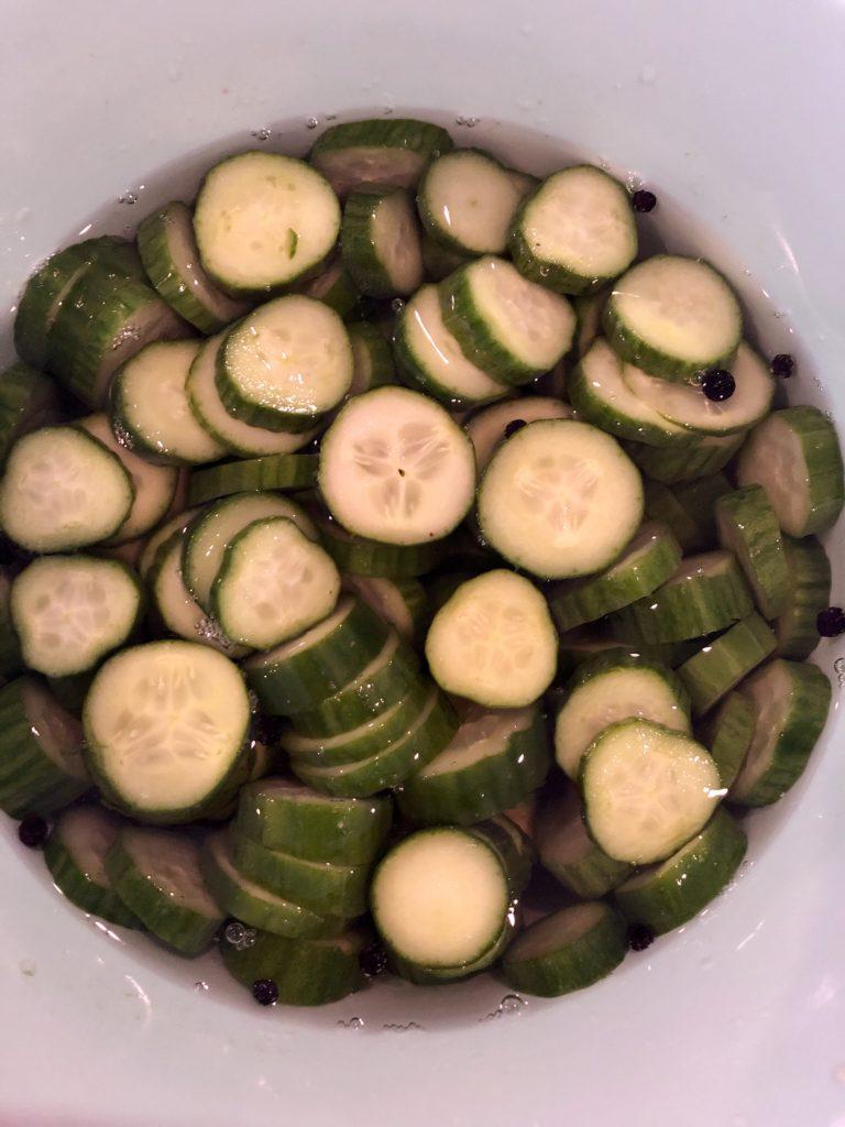 Cucumbers soaking in vinegar mixture