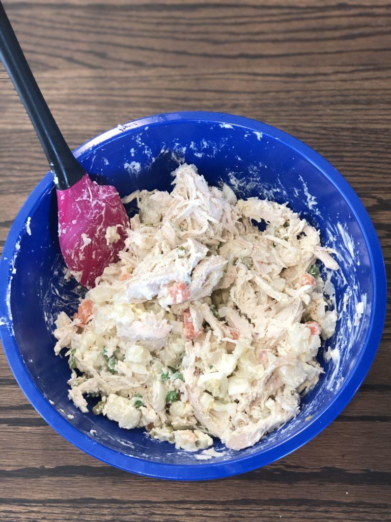 Chicken salad ingredients mixed together